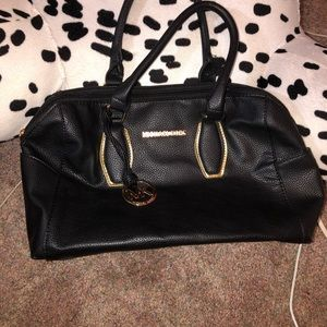Looks authentic Michael Kors bag